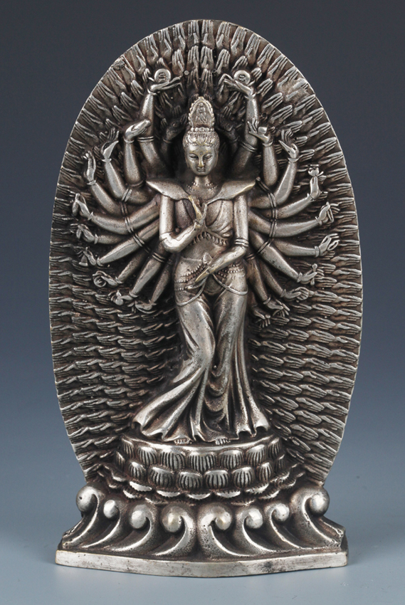 A FINELY CARVED SILVER PLATED GUAN YIN MODEL