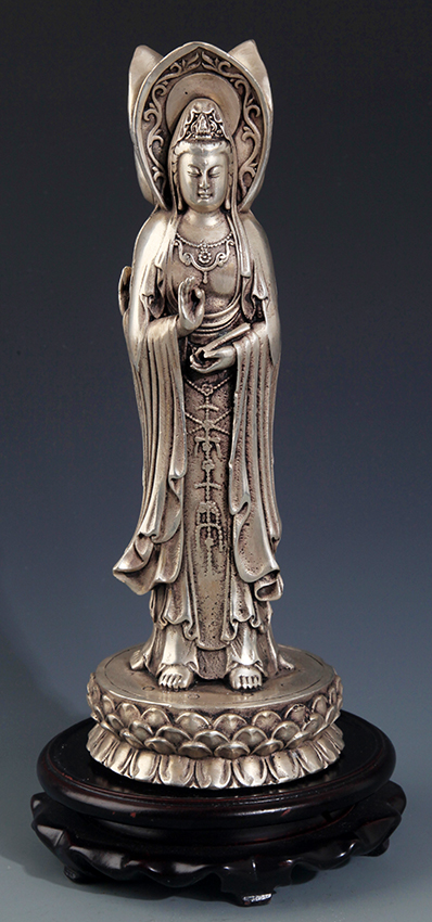 A BRONZE THREE FACE GUAN YIN BRONZE FIGURE