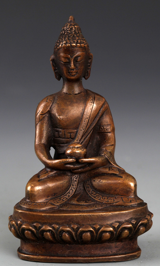 A FINELY CARVED SEATED BRONZE BUDDHA
