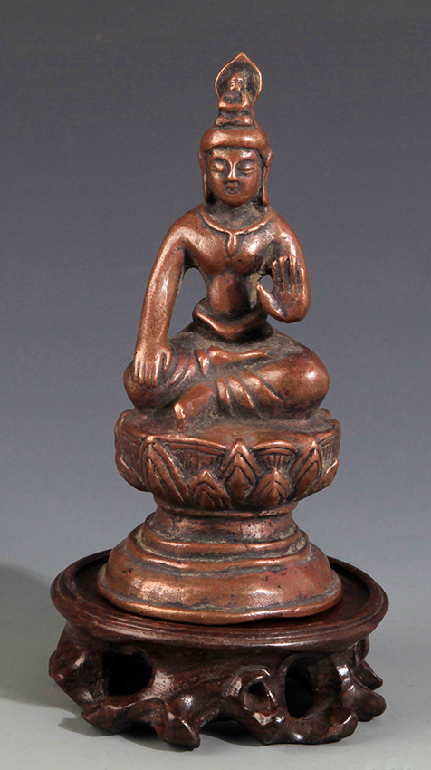 A SMALL FINELY CARVED BRONZE BUDDHA