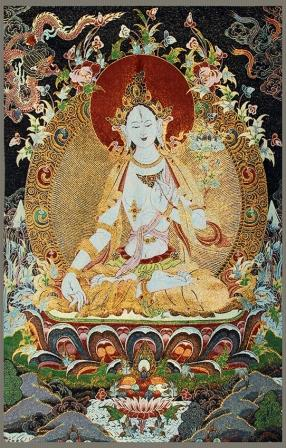 A FINE BUDDHA FIGURE ON BROCADE