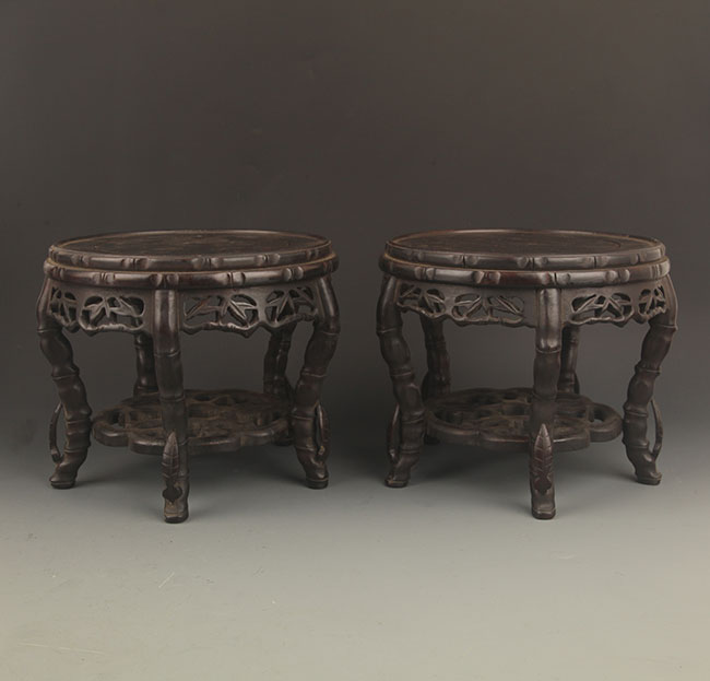 PAIR OF TALL AND DETAILED CARVED STAND