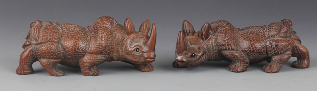 PAIR OF FINELY CARVED RHINOCEROS FIGURE