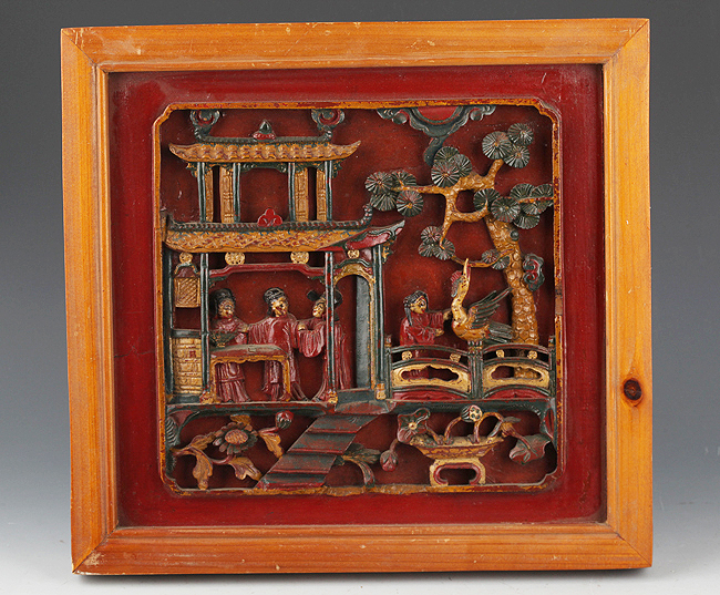 A FINELY CARVED WOODEN BOARD