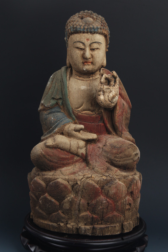 A WOOD COLORED AKSHOBHYA BUDDHA