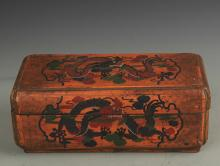 A GILT LACQUERED WOOD DRAGON PATTERN BOX WITH COVER