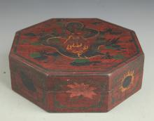 A GILT LACQUERED WOOD DRAON PAINTED EIGHT SIDE BOX