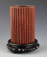 A WOODEN AND GILT BRUSH POT