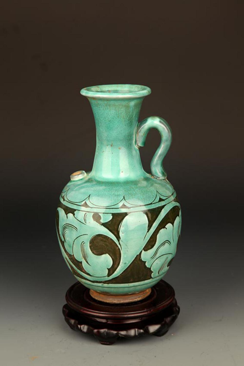 A GREEN GLAZED FLOWER CARVING PORCELAIN WATER JAR