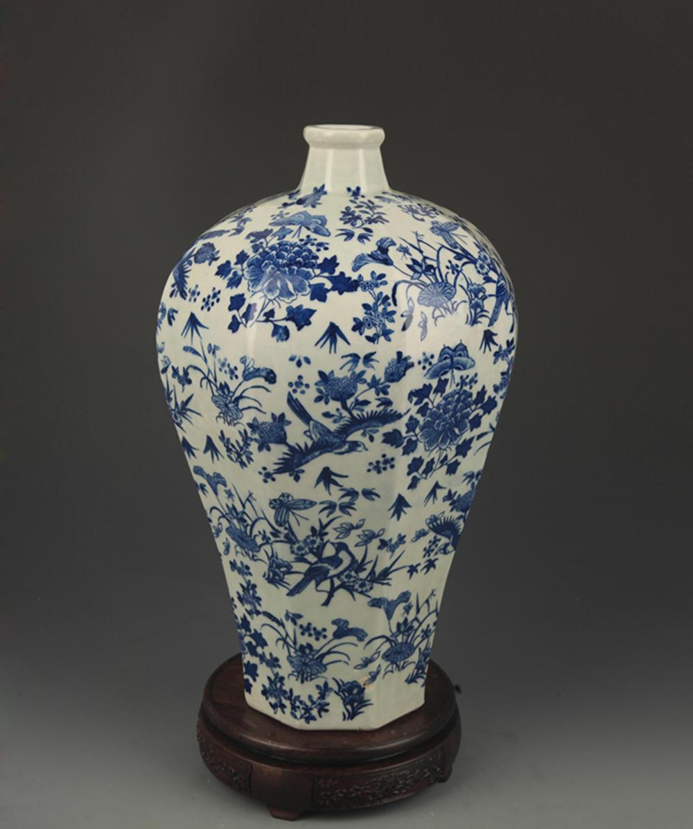 A BLUE AND WHITE, FLOWER AND BIRD PAINTED VASE