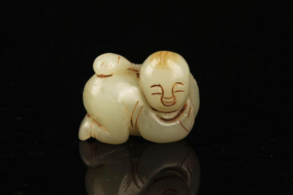 A FINE HETIAN JADE IN FIGURE OF BOY PLAYING