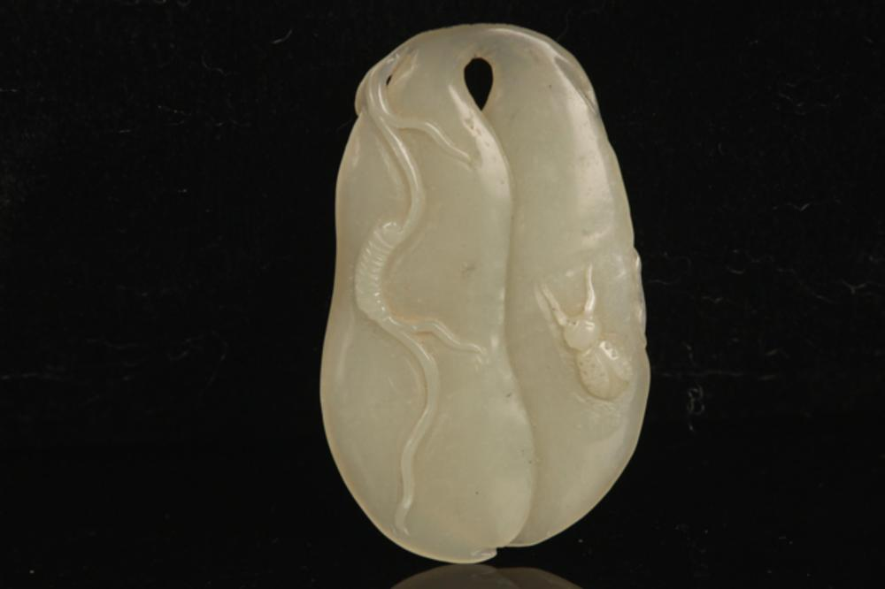 A FINE PALE CELADON JADE IN FIGURE OF BEANS