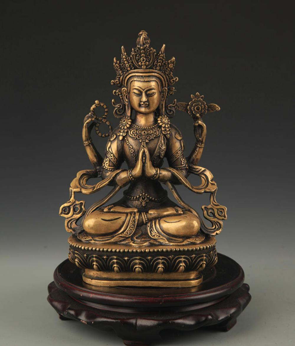 A FINELY CARVED TIBETAN FOUR ARMS GUAN YIN FIGURE