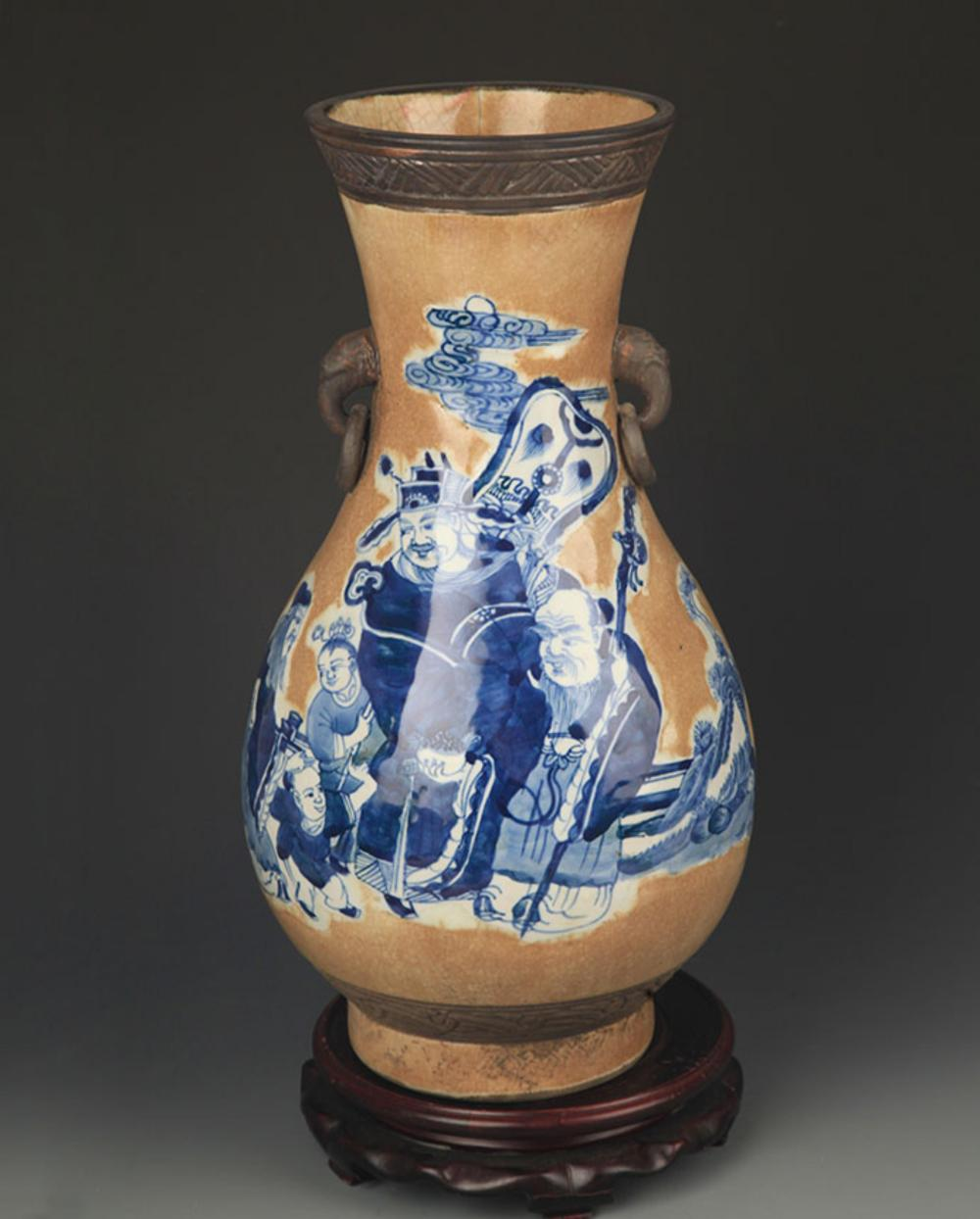 A BLUE AND WHITE STORY PAINTED ELEPHANT EAR VASE