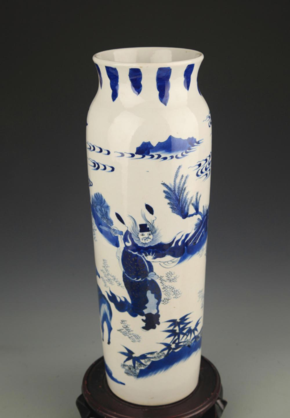 A BLUE AND WHITE STORY PAINTED BRUSH HOLDER