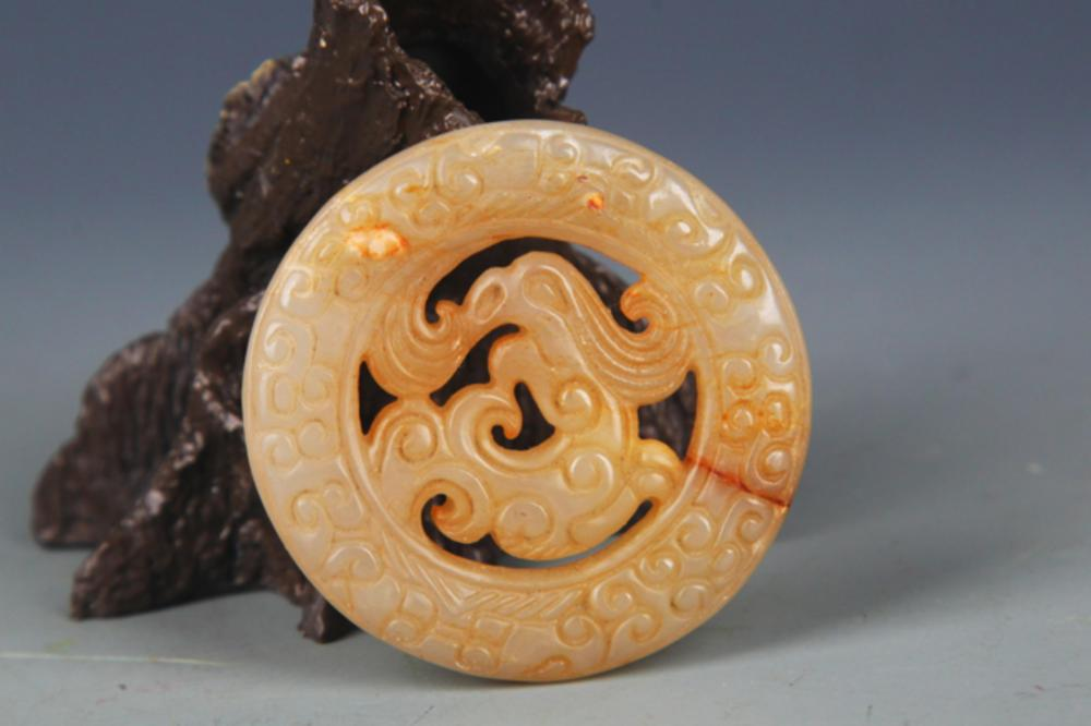 A WARRING STATES PERIOD STYLE DRAGON FIGURE JADE