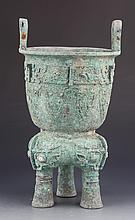 A VERY OLD LARGE CARVED BRONZE TRIPOD FOOD