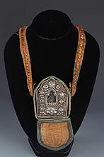 A SILVER PLATED TIBETAN RELIGIOUS AMULET,