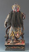 A GILT COLOR PAINTED WOODEN GUAN GONG