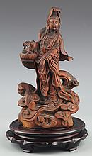 A FINELY CARVED REDWOOD IN FIGURE OF GUANYIN