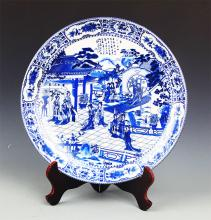A FINE STORY PAINTED BLUE AND WHITE PORCELAIN PLATE