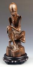 A BOXWOOD CARVING IN FIGURE OF BODHIDHARMA