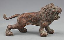 A BRONZE LION LIKE DECORATION