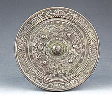 A FINELY CARVED BRONZE MIRROR