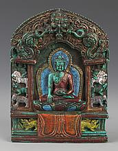 AN AKSHOBHYA BUDDHA CARVED TURQUOISE DECORATION