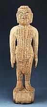 A FINELY CARVED WOODEN ACUPUNCTURE FIGURE