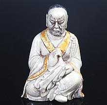 A FINELY CARVED SHOU SHAN STONE IN FIGURE OF ROHAN