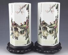 A PAIR OF STORY PAINTED PORCELAIN BRUSH POT