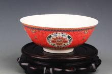 A RED GROUND FAMILLE-ROSE PORCELAIN BOWL
