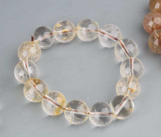 a group of three fine crystal bracelets