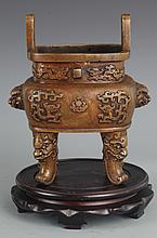 A FINELY EMBOSSED DRAGON CARVING BRONZE CENSER