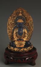 A BLUE GLASS GILT AMITAYUS BUDDHA STATUE