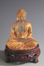 A FINE GLASS GILT AKSHOBHYA BUDDHA STATUE