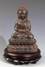 A FINELY CARVED IRON MADE AKSHOBHYA BUDDHA