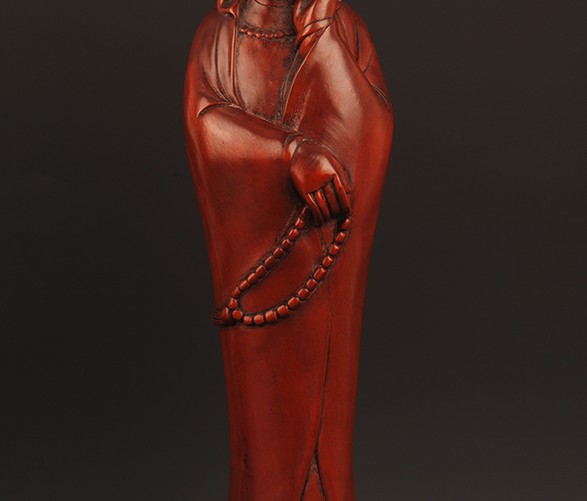 A finely carved boxwood guan yin figure