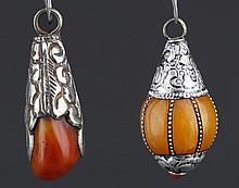 A GROUP OF TWO BEESWAX PENDANT