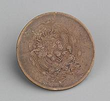 A CARVED BRONZE DRAGON COIN
