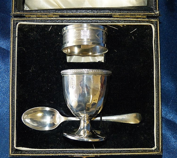 A Sheffield Silver Egg Cup and Matching Spoon in fitted black lea