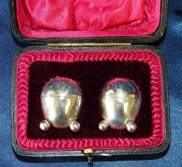 A Pair of London Silver Bullet Shape Pepper Pot on ball feet in f