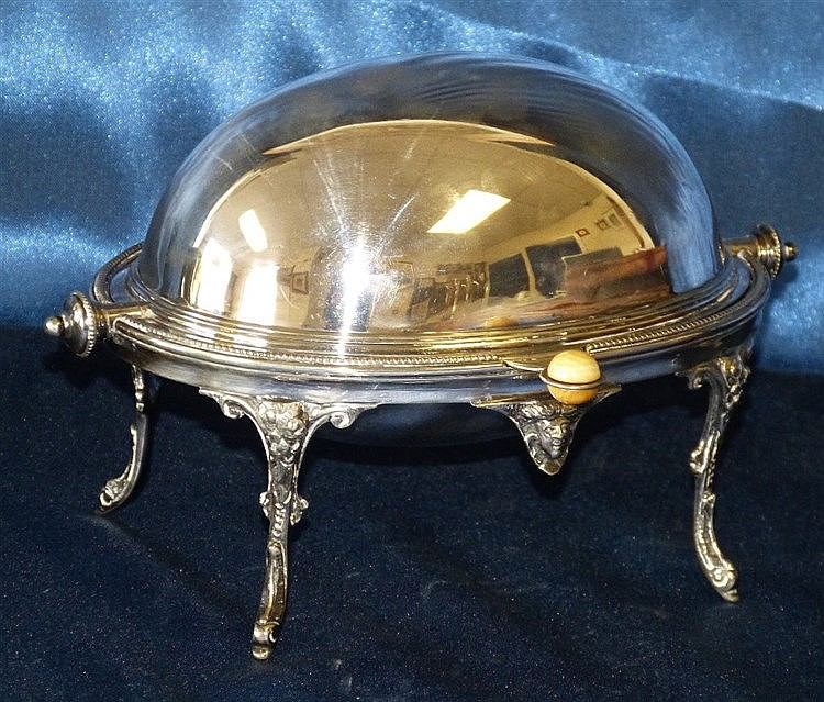 A Silver Plated Egg Shape Butter Dish having swing overhead cover