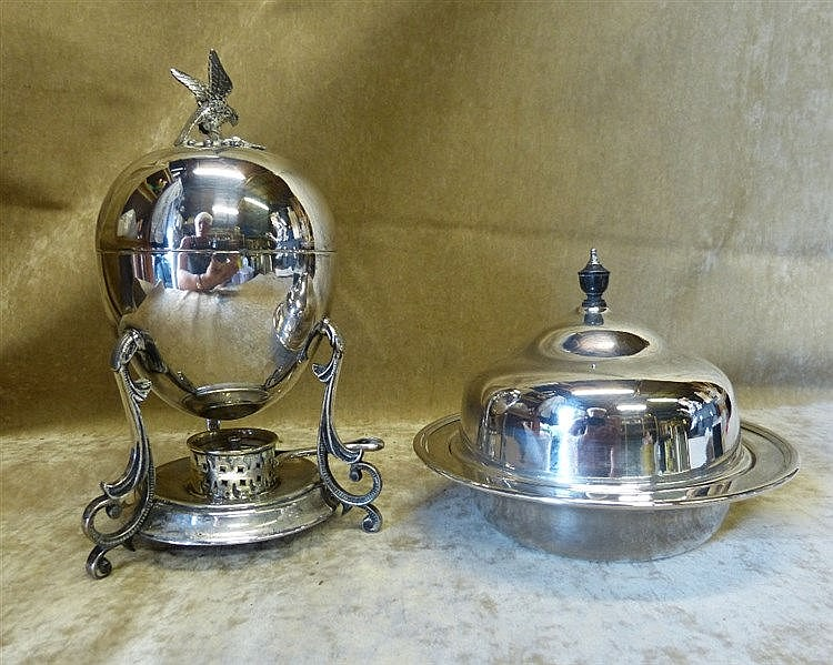 A Silver Plated Egg Warmer with cover and burner on splayed scrol
