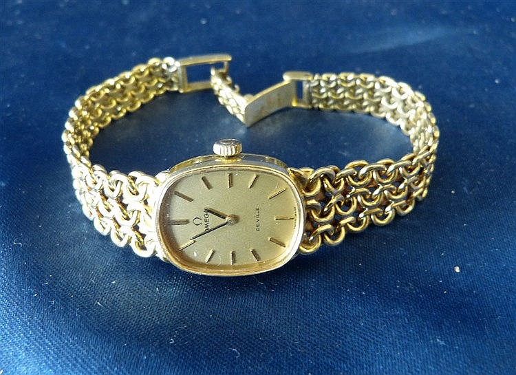 An Omega De Ville Ladies 18ct Gold Wrist Watch having matching st