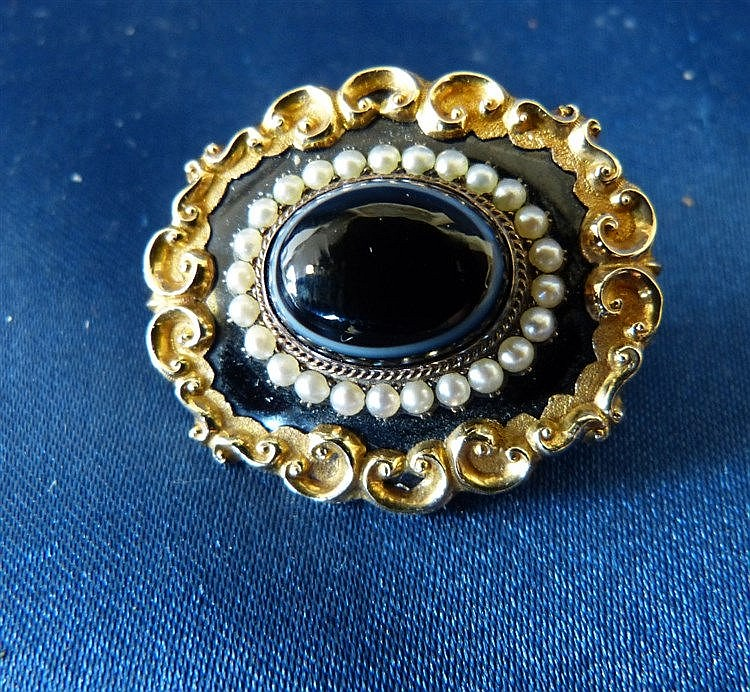 A 19th Century Gold Mourning Brooch set with centre banded agate