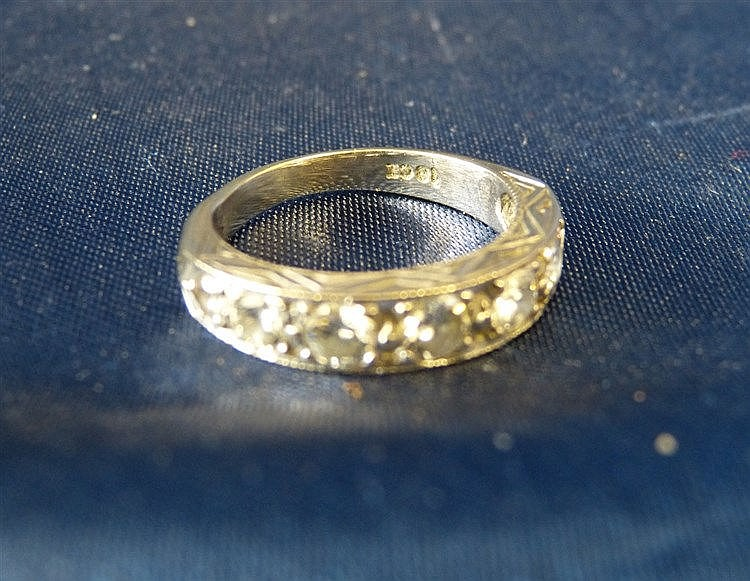 An 18ct White Gold Ladies Half Eternity Ring set with 7 graduated