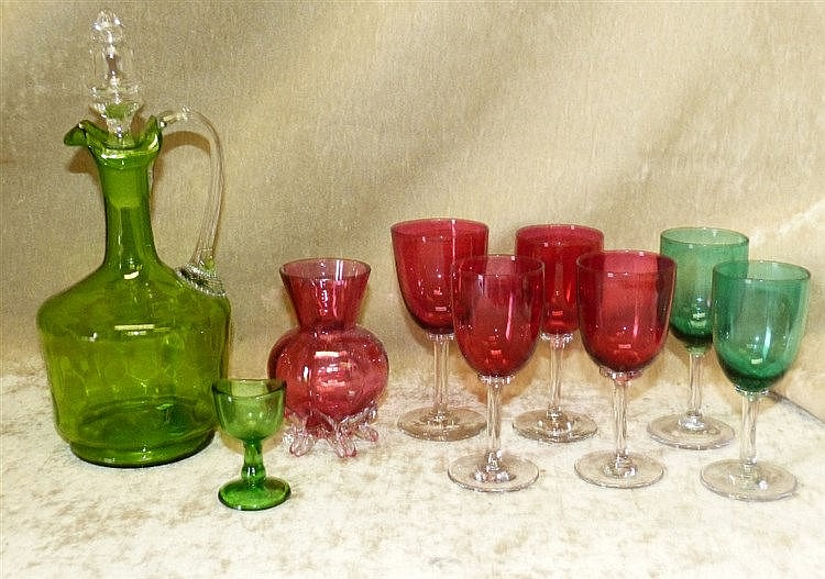 A Victorian Green Glass Bulbous Thin Neck Claret Jug with stopper