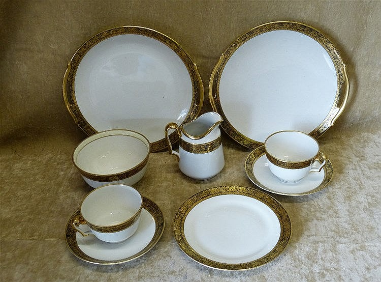 A Noritake Tea Service on white ground having black, gilt, floral